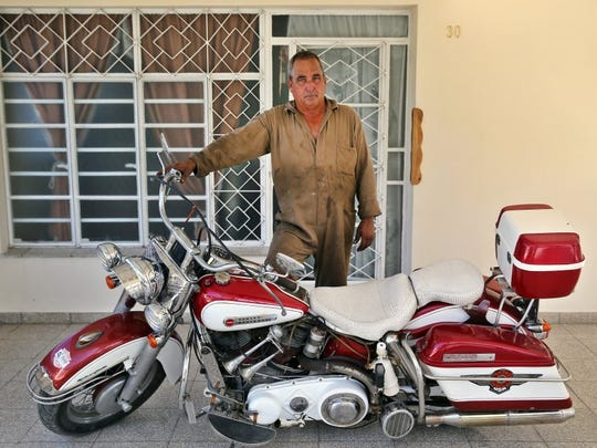 Pedro Luis Sanchez Hernandez poses with his 1960 Harley-Davidson in the municipality of Arroyo Naranjo, in Havana, on June 22, 2016. (Photo by Ernesto Salazar/Special to the Daily News)