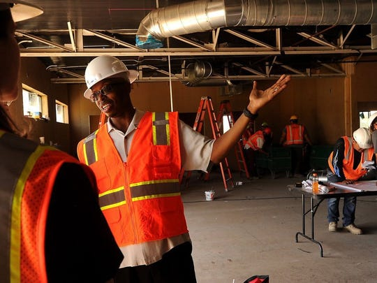 ROB VARELA/THE STAR Eric Jennings, vice president with Byrom-Davey, Inc., gives a tour of what will be the training room at the Rams practice facilities on the campus of CLU in Thousand Oaks.