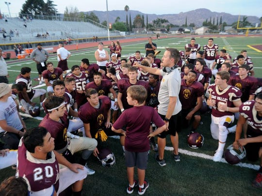 JOSEPH A. GARCIA/THE STAR Simi Valley High head coach Ryan Taggart talks with his team following a scrimmage against Hueneme High on Aug. 19.