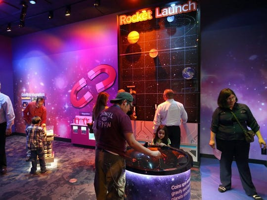 GABE HERNANDEZ/CALLER-TIMES People play with exhibits during the grand opening of the H-E-B Science Center on Friday, April 1, 2016, at the Corpus Christi Museum of Science and History in Corpus Christi.