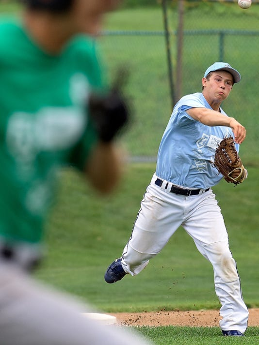 Roberto Barranca of Dallastown School District, playing for the Capital junior team, throws out a Delaware Valley batter during Keystone Games action at Shryock Field on Thursday. The Capital team lost, 4-1.