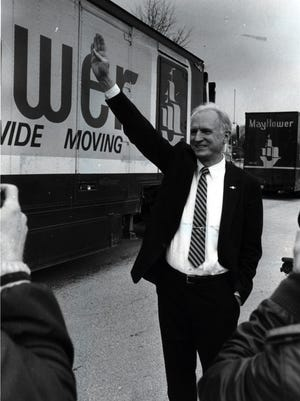 Indianapolis Mayor Bill Hudnut poses by Mayflower moving vans filled with Indianapolis Colts possessions that just arrived from Baltimore in March 1984.
