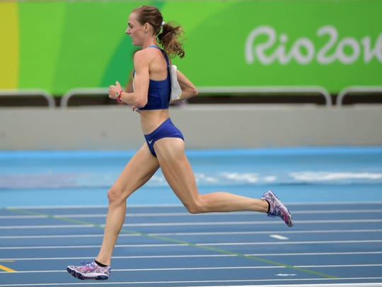 Molly Huddle (USA) competes in the women's 10,000m event at Estadio Olimpico Joao Havelange in the Rio 2016 Summer Olympic Games. Mandatory Credit: Kirby Lee-USA TODAY Sports