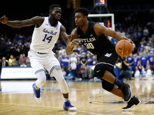 Butler forward Kelan Martin, right, drives to the basket against Seton Hall forward Ismael Sanogo