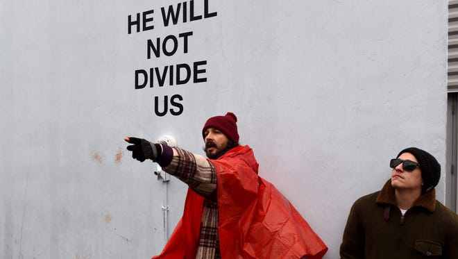 Actor Shia LaBeouf during his 'He Will Not Divide Us' livestream outside the Museum of the Moving Image in Astoria, in the Queens borough of New York Jan. 24, 2017 as a protest against President Trump.