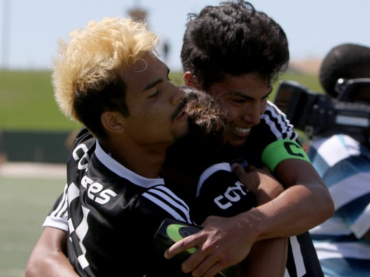 Wichita Falls High School's Richy Acosta, Adrian Botello and Alfredo Pacheco hug while celebrating their 1-0 win over El Paso Del Valle Saturday, April 8, 2017, at Memorial Stadium.