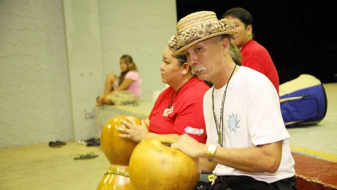 In this 2009 file photo, Frank Rabon plays the tagua and instructs in Chamorro during the Taotao Tano paractice at Barrigada community center.