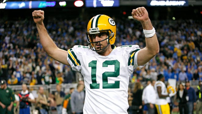 Dec 3, 2015: Green Bay Packers quarterback Aaron Rodgers (12) raises his arms in victory during the fourth quarter against the Detroit Lions at Ford Field. Packers win 27-23.