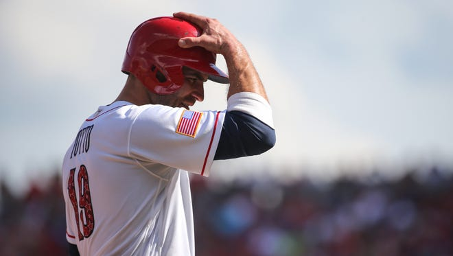 Cincinnati Reds first baseman Joey Votto (19) adjusts his helmet as he takes a lead off third base in the fourth inning during the National League baseball game between the Chicago Cubs and the Cincinnati Reds on July 1, 2017, at Great American Ball Park.