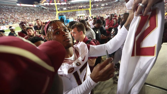 FSU's Deondre Francois signs autgraphs after the Seminoles' Garnet and Gold Spring Game at Doak Campbell Stadium on Saturday, April 14, 2018