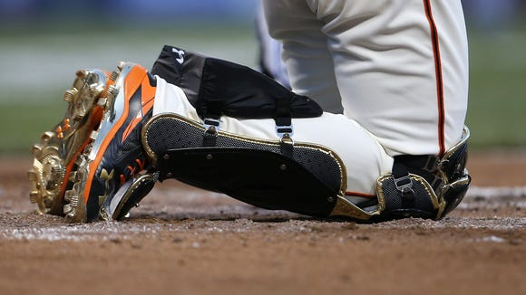 National League catcher Buster Posey sports bright-colored shoes in the first inning during the 2015 MLB All-Star Game.