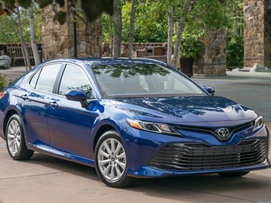 A Blue 2018 Toyota Camry Midsize Sedan