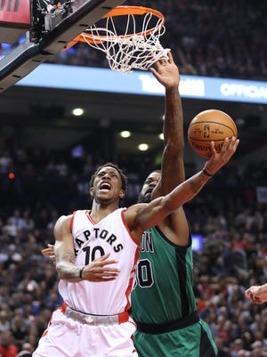 Toronto Raptors guard DeMar DeRozan (10) scores a basket against Boston Celtics forward Amir Johnson (90) at Air Canada Centre. DeRozan finished with 43 points in Friday's win over Celtics, a career high for the Raptors' guard.