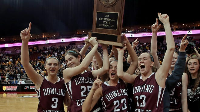 Dowling Catholic players celebrated a Class 5-A championship title in 2014. The Maroons are one of four returning state champs that enter the season ranked No. 1.