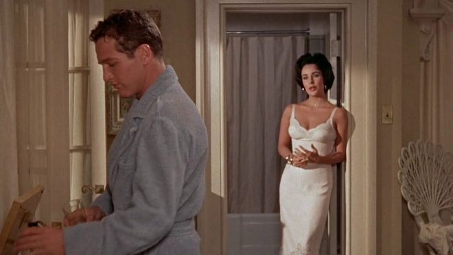 "A scene from ""A Cat on a Hot Tin Roof,"" starring Paul Newman and Elizabeth Taylor."