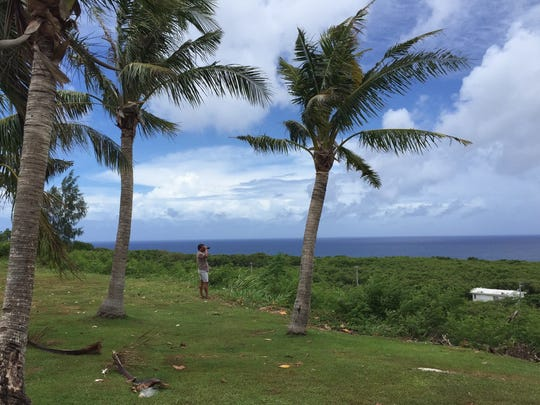 Ken B. Duenas checks out the view from Mangilao as the weather system approaches Guam.