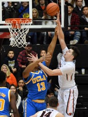 Dec 30, 2016; Corvallis, OR, USA; Oregon State Beavers forward Drew Eubanks (12) shoots the ball over UCLA Bruins forward Ike Anigbogu (13) in the first half at Gill Coliseum. Mandatory Credit: Scobel Wiggins-USA TODAY Sports