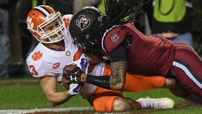 Clemson wide receiver Hunter Renfrow (13) catches a touchdown pass against South Carolina during the third quarter in Williams-Brice Stadium in Columbia on Saturday.