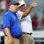 Head coach Mark Stoops of the Kentucky Wildcats talks to head coach Steve Spurrier of the South Carolina Gamecocks prior to their game at Williams-Brice Stadium on October 5, 2013 in Columbia, South Carolina.