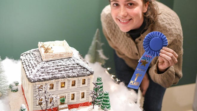 Martina Berger with her 2019 Discover Portsmouth winning gingerbread house, a scale model of the full-sized home that her grandfather, architect William E. Gindele, designed and built in Portsmouth.