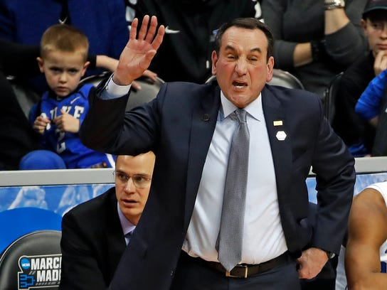 Duke head coach Mike Krzyzewski shouts instructions during the first half of an NCAA men's college basketball tournament second-round game against Rhode Island, in Pittsburgh, Saturday, March 17, 2018. Duke won 87-62. (AP Photo/Gene J. Puskar)