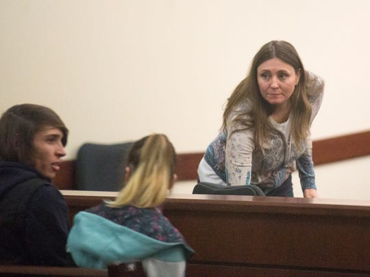 Defendant Anna Marie Schroth looks to her family after her sentencing hearing Tuesday in Aztec District Court.