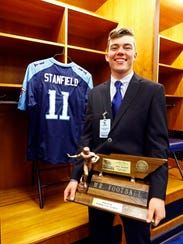 Waverly Central's Gavin Stanfield stands with his Mr. Football trophy on Nov. 27.