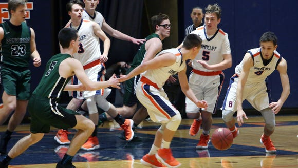 Briarcliff controls a loose ball against Pleasantville