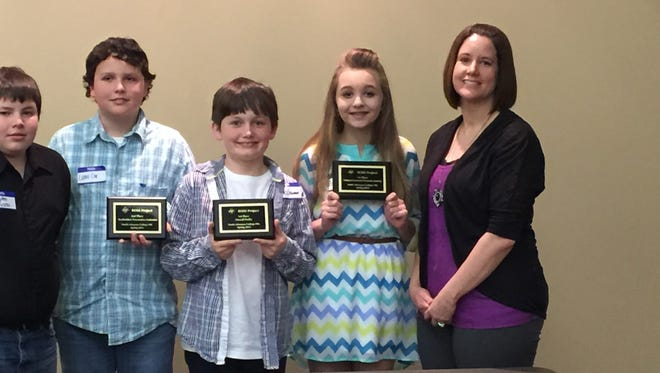 The Cotter sixth-grade Business Opportunities for Student Success team racked up awards at recent business-award ceremony at the North Arkansas College campus in Harrison. The team spent eight weeks analyzing data and working as a team running a multimillion dollar cellphone company through a business simulation. The team captured first in overall cumulative profits, first in overall balance scorecard and second in business presentation to stockholders. Team members shown are, from left, Jayden Hutchison, Lane Cox, James Crownover, Allie Crownover and Gifted & Talented teacher and team facilitator Monica Springfield. Team members Landon Francis and Anna Haynes were not available for the photo.