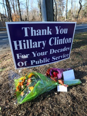 A sign thanking Hillary Clinton for her decades of public service is placed near her home on Old House Lane in Chappaqua.