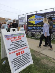 A sign with new festival rules is seen, Friday May 20, 2016, during the St. Joan of Arch Spring Festival in St. Clair Shores.
