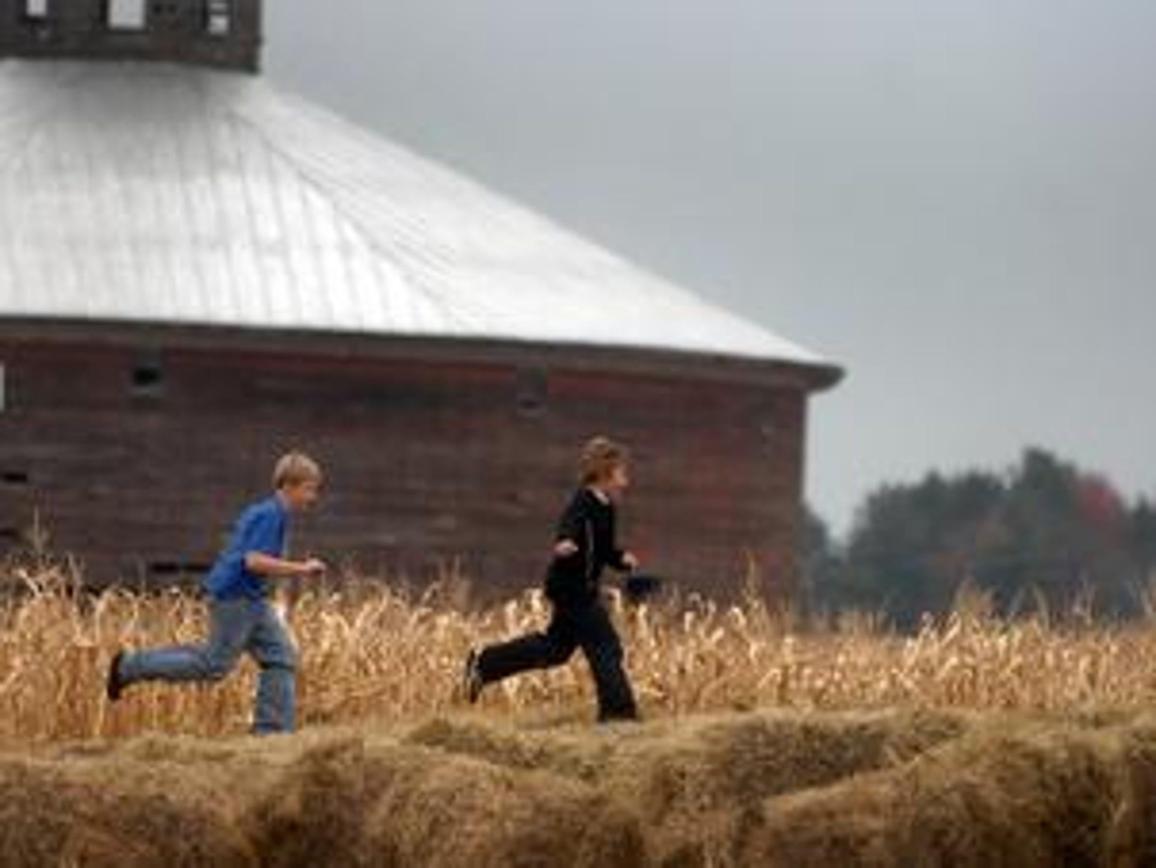 Michael Verick, 12, left, and August Geisen, 9, both