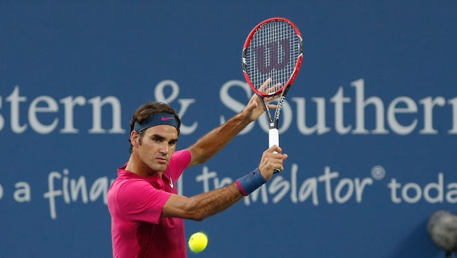 Swiss tennis player Roger Federer fires a return to Roberto Bautista Agut in the second round of the Western & Southern Open Tuesday. Federer won 6-4, 6-4.