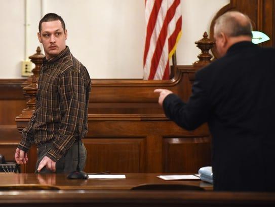 Prosecutor Paul Hagerman speaks to his client, John