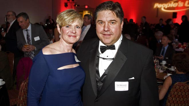 Brigitte Ritchie, the 2016 Tim Halvorson Business Person of the Year Award Winner, smiles with Tim Halvorson at the 2016 BBA Awards at the Hilton Burlington on Thursday.