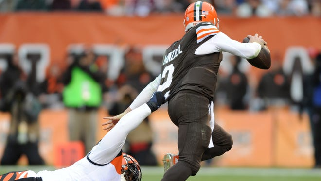 Dec 14, 2014; Cleveland, OH, USA; Cincinnati Bengals defensive tackle Brandon Thompson (98) sacks Cleveland Browns quarterback Johnny Manziel (2) during the third quarter at FirstEnergy Stadium. The Bengals beat the Browns 30-0.