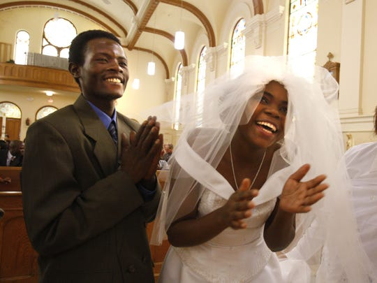 Severina Maniwakiza, left, and his bride, Maria Jururyabake
