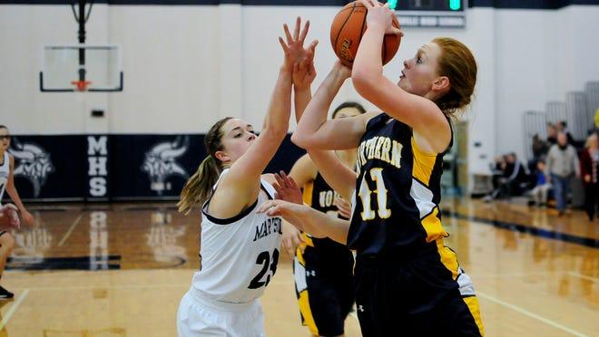 Port Huron Northern sophomore Kendyl Keyes takes a shot over Marysville senior Liz Sturtridge during the season opening girls basketball game Friday at Marysville High School.