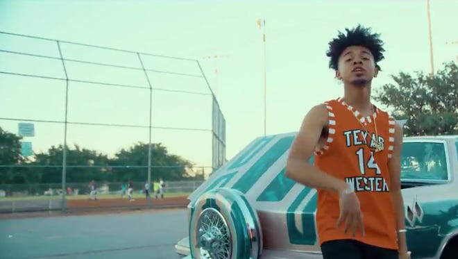 "El Paso rapper Evander Griiim wears a Texas Western jersey in his video for ""The Step,"" which aired on BET Jams."