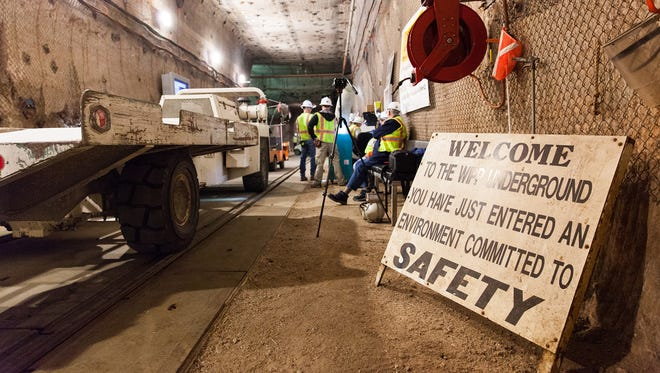 A transport waits underground to carry waste to Panel 7.