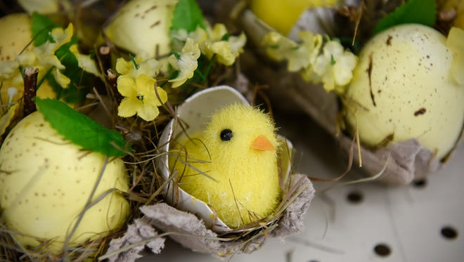 Rustic-styled small Easter eggs, complete with newly hatched chicks, are on display in the Easter decorating section Friday, March 31, at Crafts Direct in Waite Park.