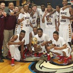 Pearl River Community College's men's basketball team celebrates after winning the MACJC State Championship Thursday.