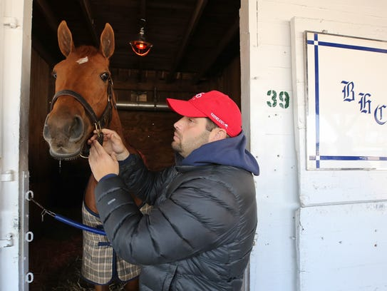 Trainer Brad Cox with Monomoy Girl who is entered in