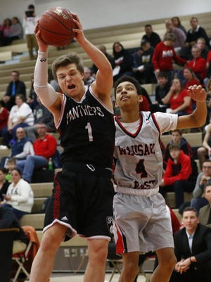SPASH's Beau Rosenthall, grabs a rebound in front of Wausau East's Chris Nash during a Wisconsin Valley Conference boys basketball game earlier this season. Both teams will play in WIAA sectional semifinal games Thursday.