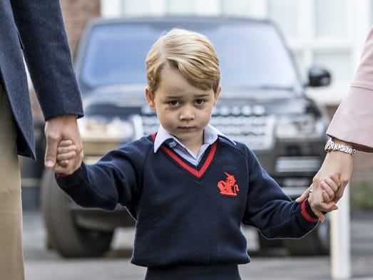 Prince George arrives for his first day at Thomas's