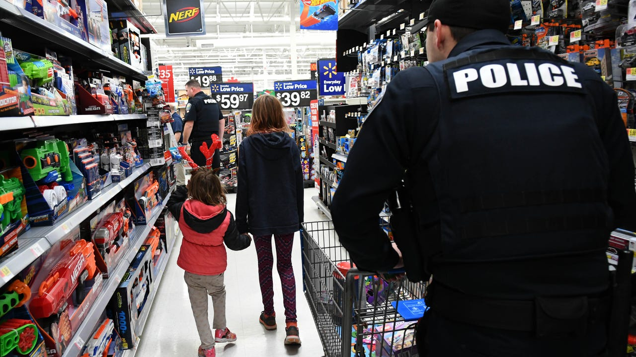 Members of the West Melbourne PD, Palm Bay PD and Brevard County Fire Rescue give 140 kids in south Brevard a chance to 'Shop with a Cop' Thursday at Walmart. Video by Craig Bailey. Posted Dec. 14, 2017.