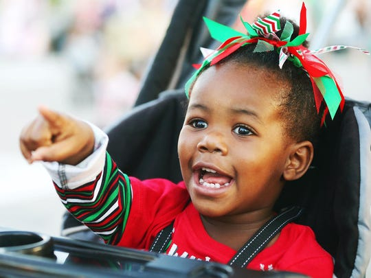 Deja C., 2, was among the thousands of kids enjoying the Holiday Festival of Lights event in December in downtown Cape Coral. A tree lighting ceremony, performances by dance troupes, a snow slide and food were featured at the annual event.