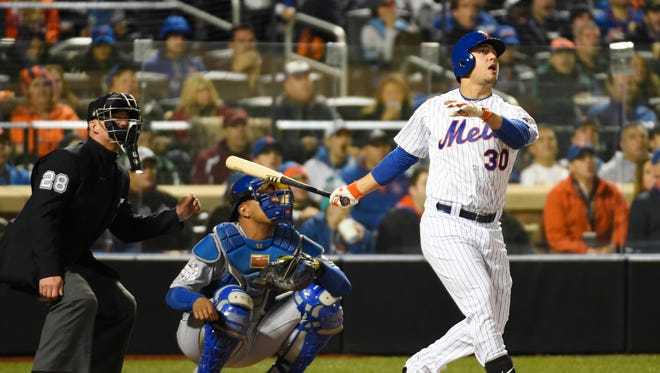 Michael Conforto hits a solo home run in the third inning.