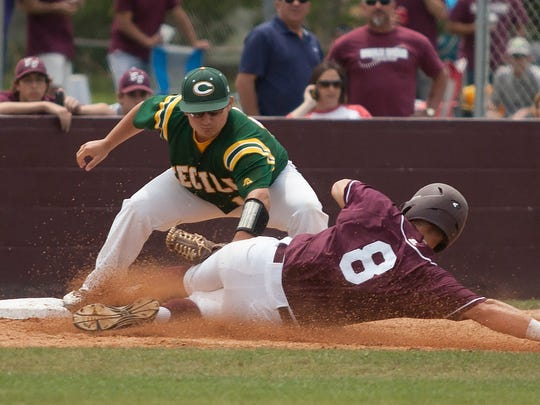 The Tiger's Julian Leon is tagged out by third baseman