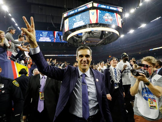 Villanova head coach Jay Wright celebrates after the NCAA Final Four tournament college basketball championship game against North Carolina, Monday, April 4, 2016, in Houston. Villanova won 77-74. (AP Photo/David J. Phillip)